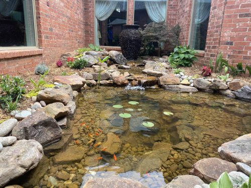 Small ecosystem pond with bubbling fountain built in North Oklahoma City by Oklahoma Ponds